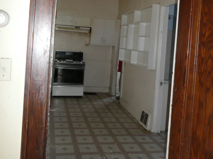 [Photo: kitchen before]